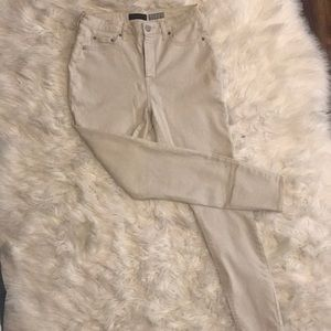 Cream colored high waisted jeggings